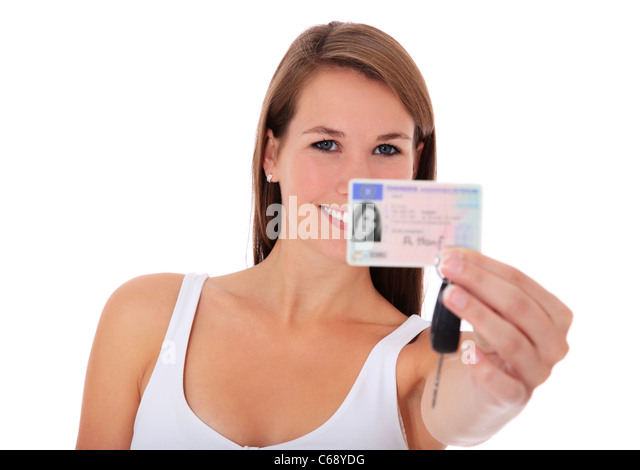 Young woman presenting her driver´s license. All on white background. - Stock Image