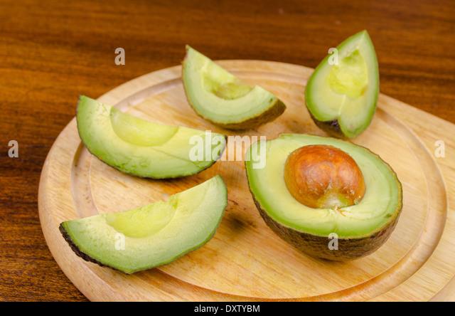 avocado over a wooden boad - Stock Image
