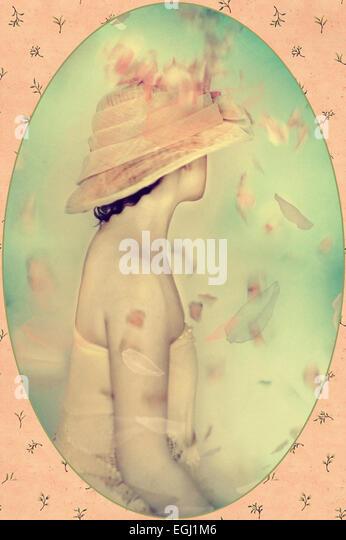 beautiful woman in fancy hat - Stock Image