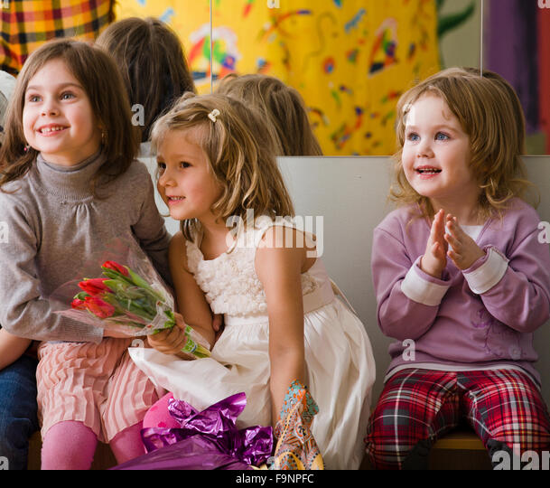 three little diverse girls at birthday party having fun - Stock-Bilder