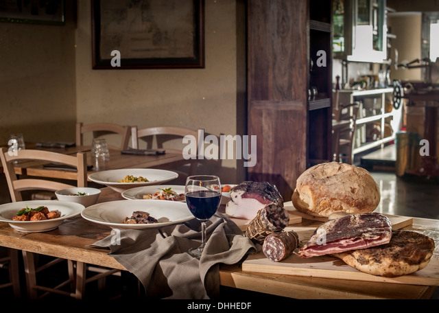Rustic display of traditional Italian food in restaurant - Stock Image