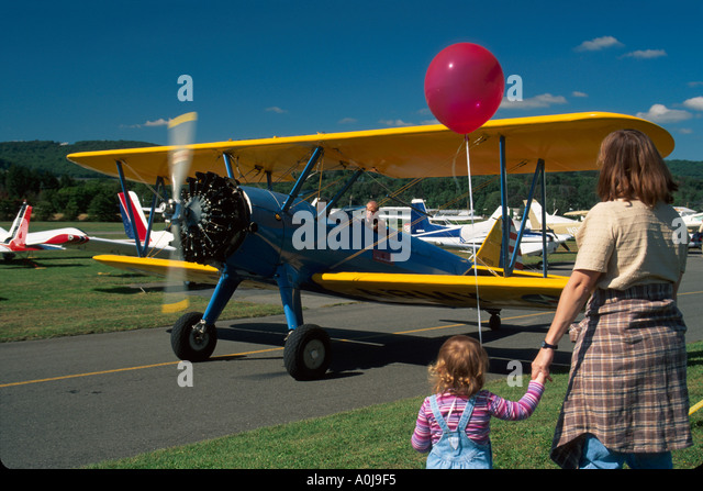New Jersey Lincoln Park Airport antique biplane family watching - Stock Image