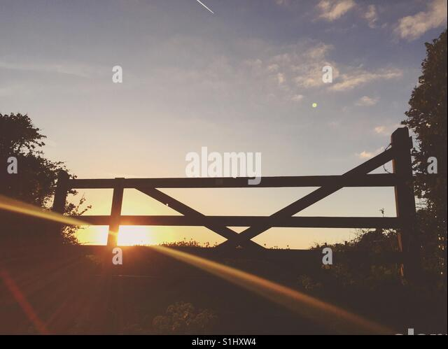Sunset through a gate - Stock Image