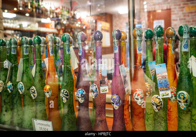 Raw of Limoncello liqueur bottles, Venice, Italy - Stock Image