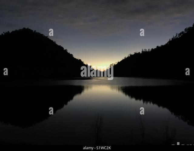 Sunrise in lake of the mountain - Stock Image