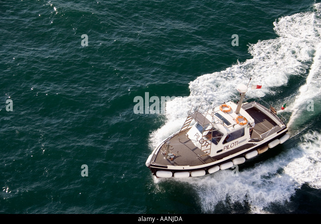 Pilot Boat Cagliari Sardinia piloti  water wave holiday vacation destination outside outdoor outdoors coast coastal - Stock Image