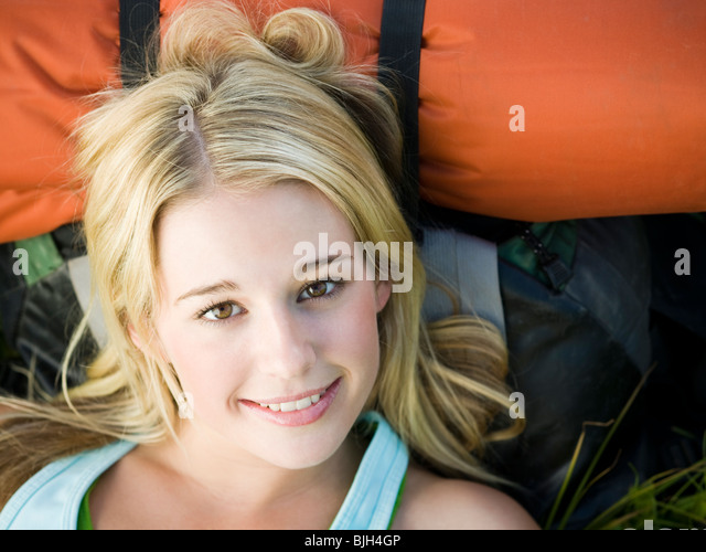 backpackers hiking through the wilderness - Stock Image