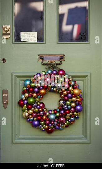Christmas Garland on Door. Garland of baubles hanging on door. - Stock Image