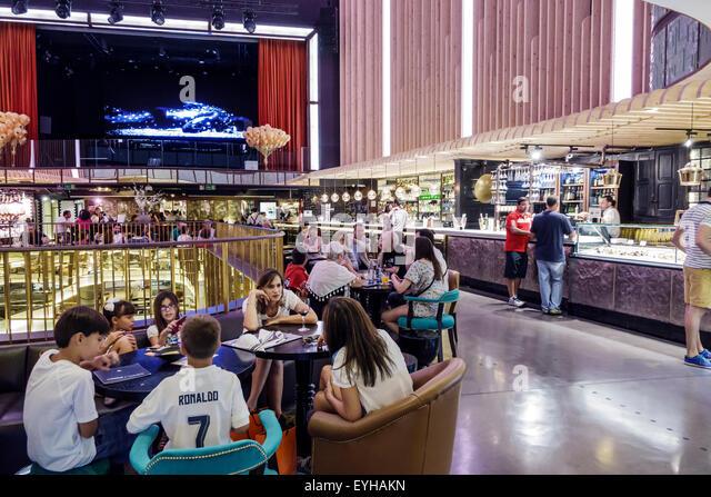Madrid Spain Europe Spanish Recoletos Salamanca Calle de Goya Platea Madrid shopping food court converted movie - Stock Image