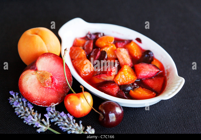 Stone fruits baked in ramekin with lavender, by pastry chef Laurie Pfalzer, Pastry Craft - Stock Image