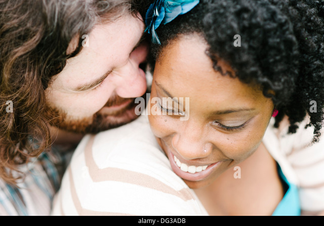 Smiling Interracial Couple, Close Up, High Angle View - Stock Image
