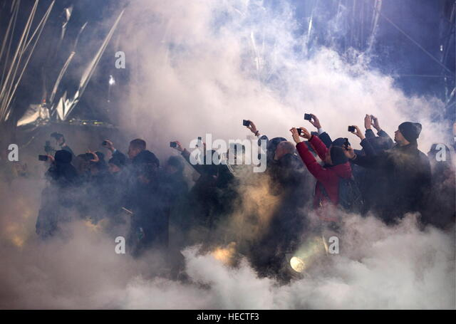 Kiev, Ukraine. 20th Dec, 2016. People taking pictures of Antonov An-132D, a new multi-role transport aircraft, presented - Stock Image