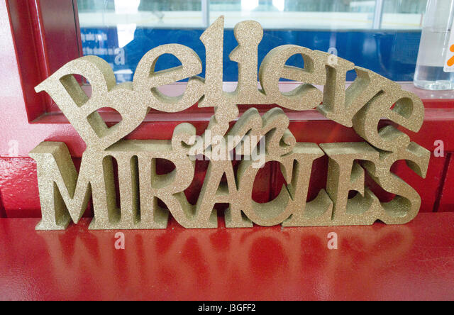Hope message cut out in wood material 'Believe in Miracles'  St Paul Minnesota MN USA - Stock Image