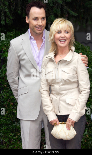Singer and actress Lulu and David Furnish join other celebrities for a party in Carlyle Square in fashionable Chelsea. - Stock Image
