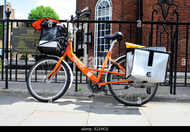 TNT post bicycle delivery in South Kensington, UK. - Stock Image