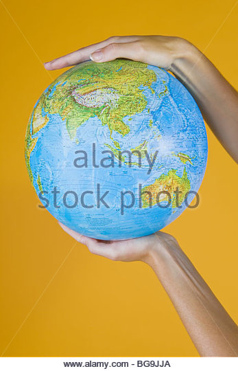 Hands Holding A Globe - Stock Image