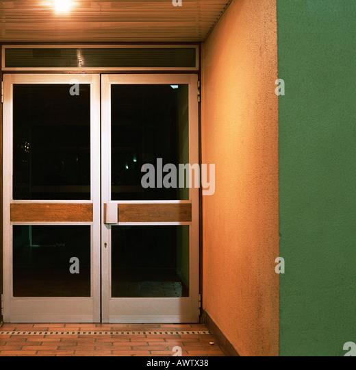 Closed doors at night - Stock Image