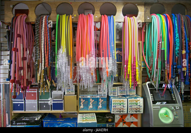 Hookah pipe hoses for sale at the Best Buzz Hookah Shop in the Little Egypt section of Astoria, Queens, New York. - Stock Image