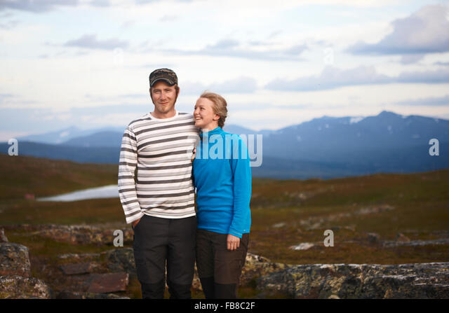 Sweden, Jamtland, Portrait of couple in mountains - Stock Image