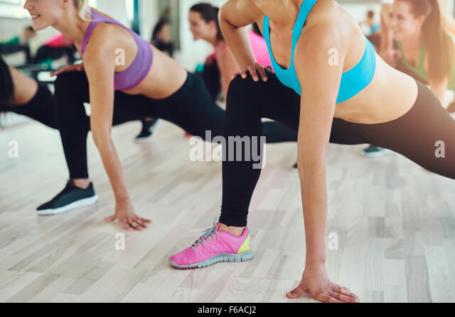 fitness, sport, training, gym and lifestyle concept - close up of people exercising in the gym - Stock Image