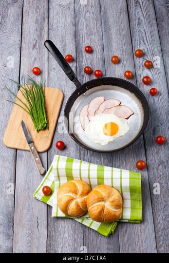 Fried egg and ham breakfast - Stock Image