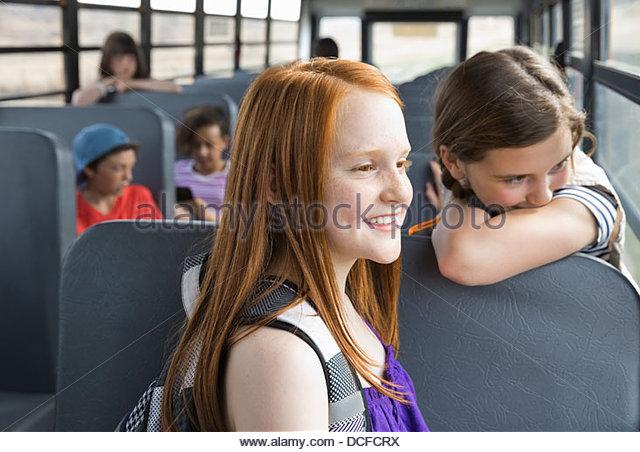 Schoolgirls looking out bus window - Stock Image