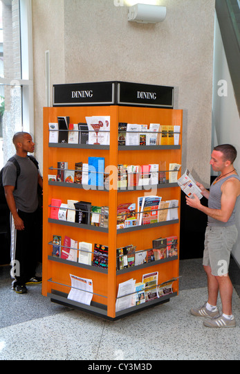Rhode Island Providence Sabin Street Visitor Information Center centre Black man kiosk brochures booklets dining - Stock Image
