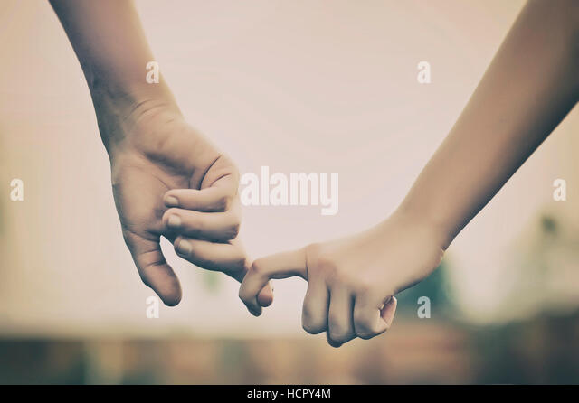 Couple holding hands. Love concept - Stock Image
