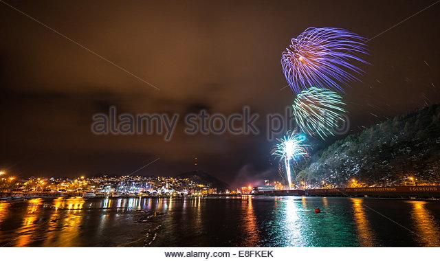 Norway, Rogaland, Egerund, Fireworks on windy evening - Stock Image
