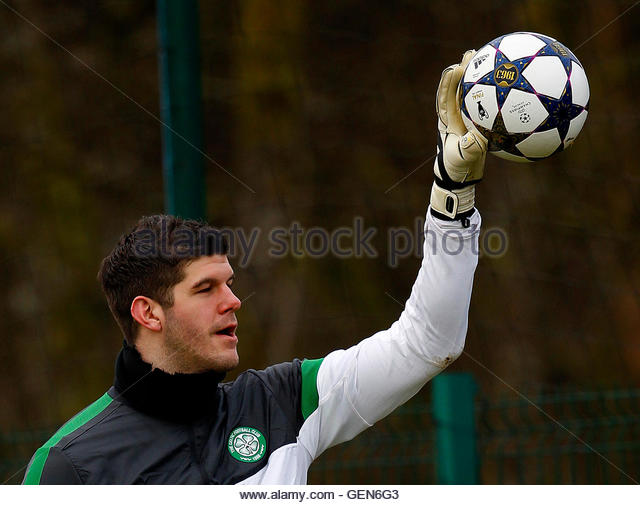 Celtic's goalkeeper Fraser Forster holds a ball with one hand during a team training session, ahead of the Champions - Stock Image