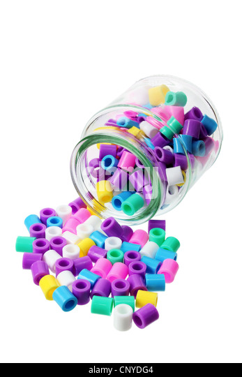 Bottle with Plastic Beads - Stock Image