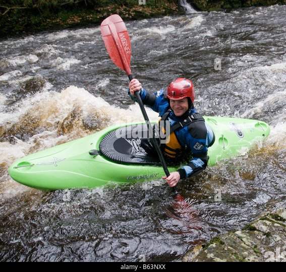 A canoeist on a river in the UK - Stock Image