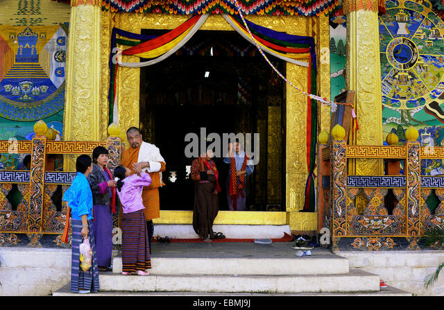 Visitors in Punakha Dzong fortress, Punakha, Punakha district, Bhutan - Stock Image