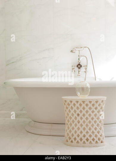 detail of marble bathtub and faucet - Stock Image