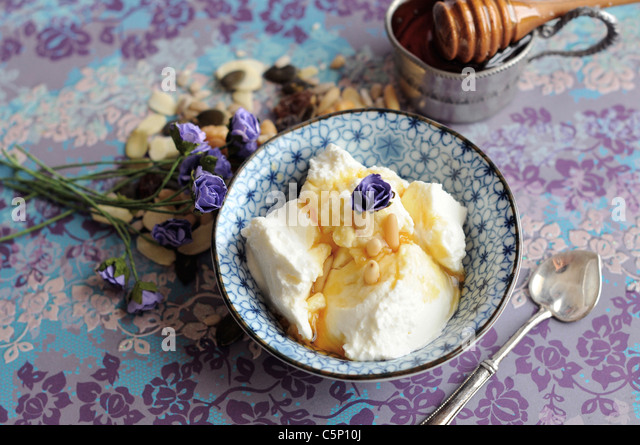 Greek yoghurt with honey and pine nuts - Stock Image