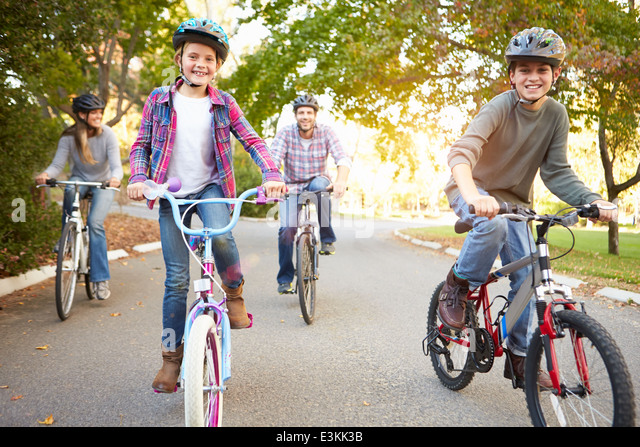 Family On Cycle Ride In Countryside - Stock Image