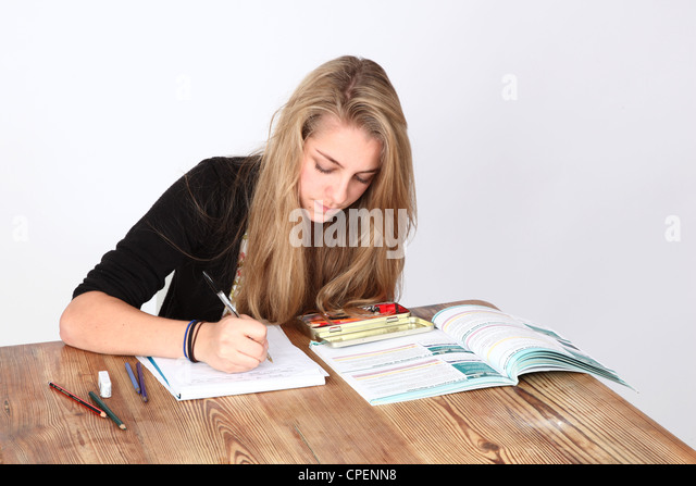 Teenage girl studying. - Stock Image