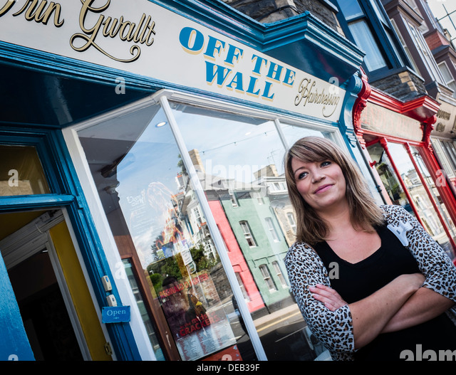 Kimberley Michelle Lewis, self employed owner of Off The Wall hair salon, Northgate St, Aberystwyth, standing outside - Stock Image
