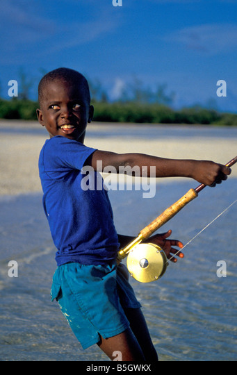 Bahamas andros island young Bahamian boy with fly rod - Stock Image
