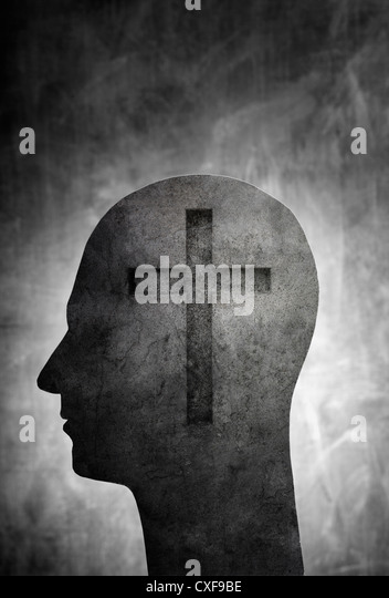 Conceptual image of a head with a christian cross symbol. - Stock-Bilder