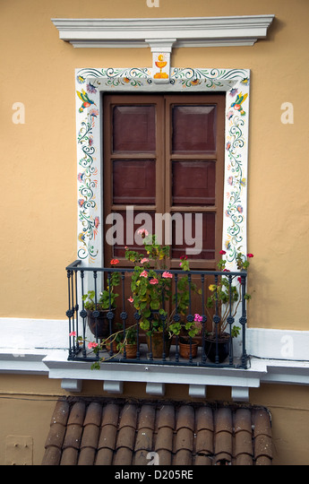 A decorated window adorns a colonial house in the historic centre of Unesco-listed Quito, Ecuador's capital - Stock Image
