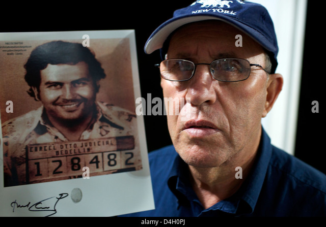 Roberto Escobar with a picture of his brother Pablo, Medellin, Colombia, South America - Stock Image