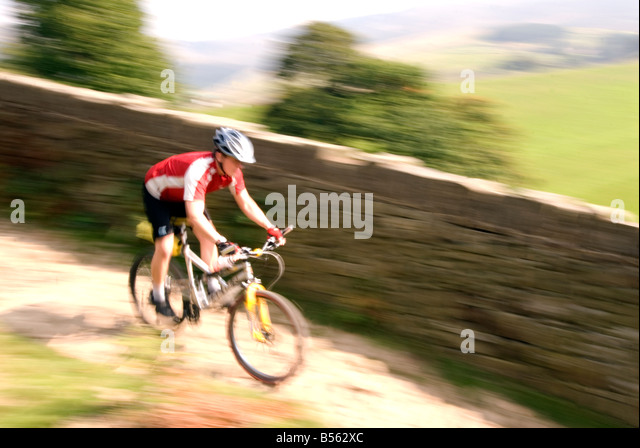 mountain biking in the Peak District National Park Derbyshire UK England GB Great Britain - Stock Image