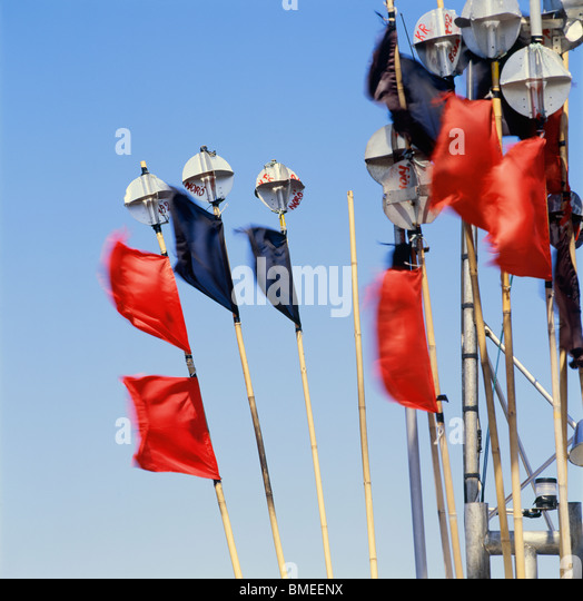 Poles with fishing flags - Stock-Bilder