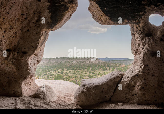Looking Out Over Bandelier National Monument from a small cave - Stock Image