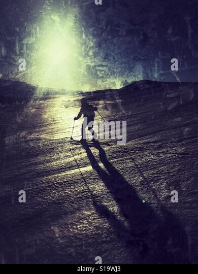 Telemark skiing into the sun - Stock Image
