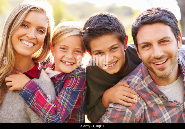 Portrait Of Family In Countryside - Stock Image