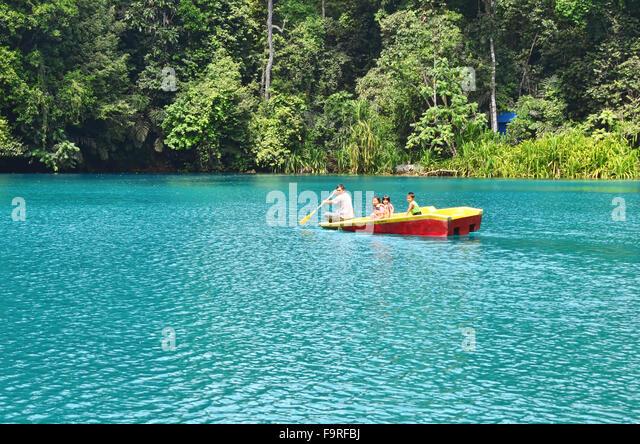 A boat in Labuan Cermin Lake - Stock Image