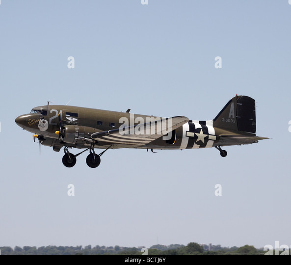 A Douglas C-47 warbird peforms a fly-by at an air show in Janesville, Wisconsin.  This plane is operated by the - Stock Image