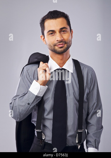 Portrait of a young and successful businessman in his formal suit - Stock Image